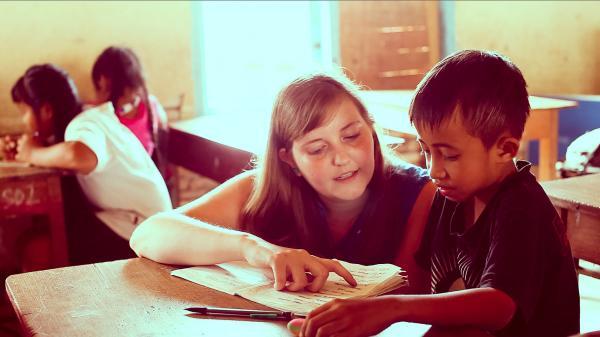 volunteer teaching a child