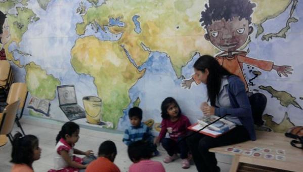 a volunteer teaching small children