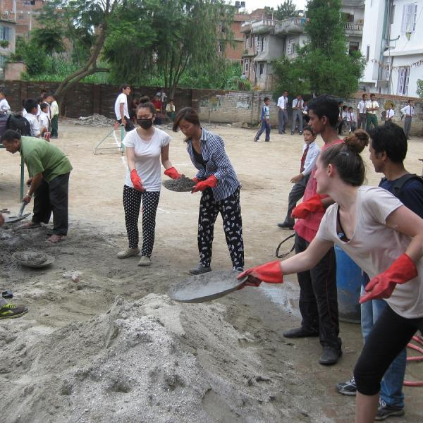 Projects Abroad volunteers digging on a Disaster Relief project site in Nepal