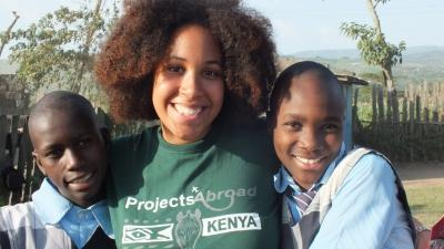 Student posing with local children, Kenya