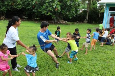Projects Abroad volunteer with students in a tug of war, Samoa