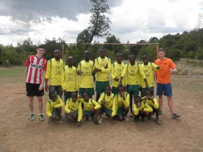 Volunteers with the Soccer team they coached in Kenya
