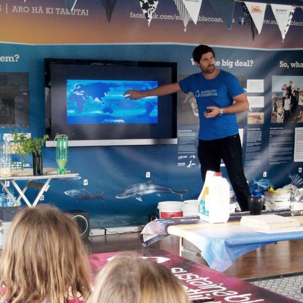 A volunteer presenting conservation ideas