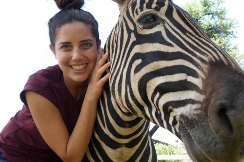 girl holding a zebra