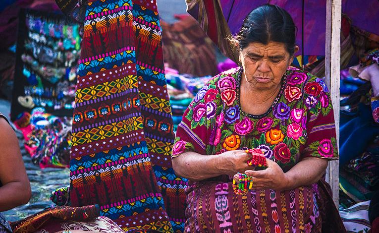 Guatemalan woman at a textile market