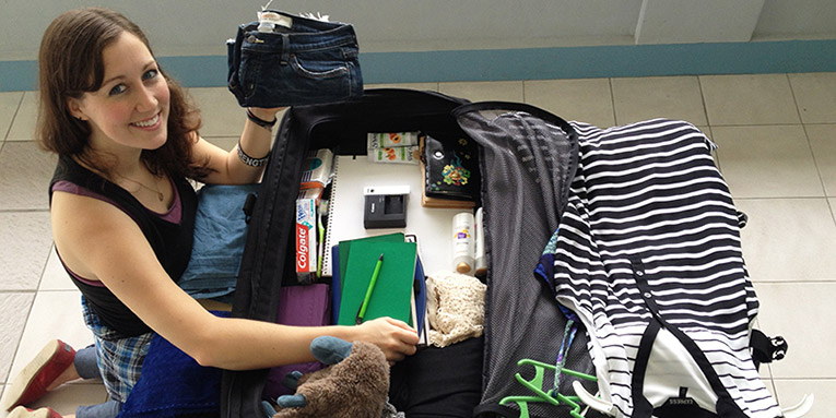 A student packing for study abroad.