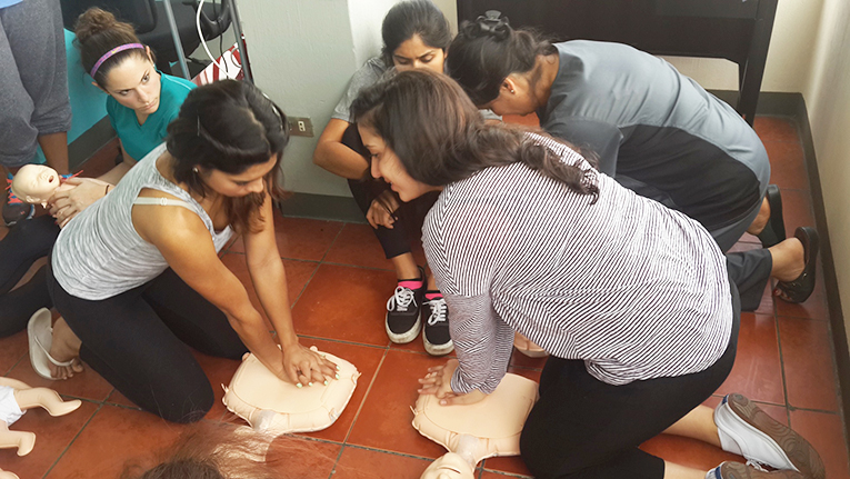 Studnets teaching CPR at an orphanage in Guatemala