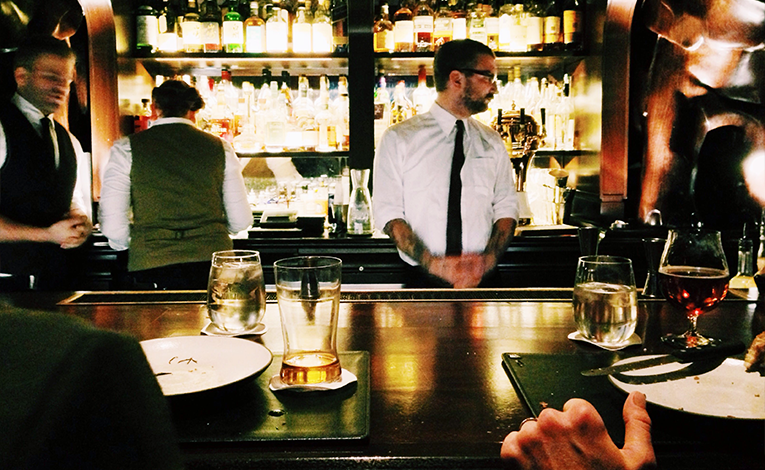 Bartenders standing at a bar