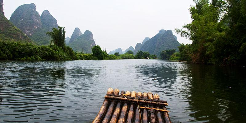 Grow rich with beautiful memories like rafting down the Li River in China.