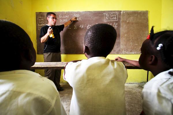 Teaching children in an orphanage in Haiti