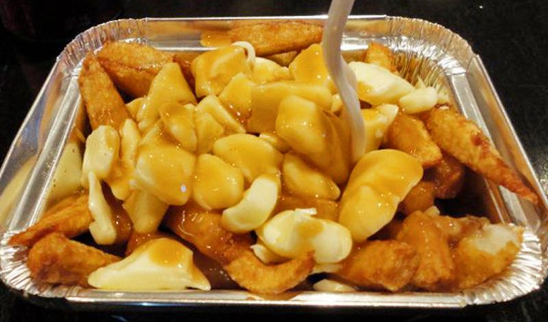 Poutine, a famous dish originating from Quebec.