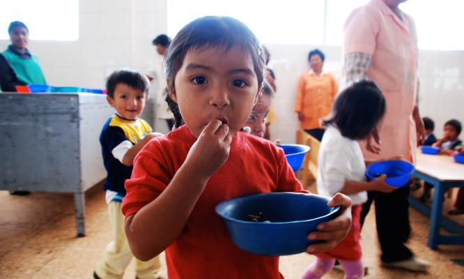 A young girl enjoys a snack prepared by volunteers. Pictures like these help people connect with your project and create a successful campaign.