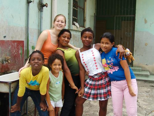 Volunteer with children in Ecuador