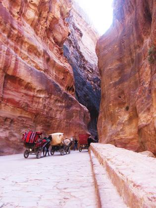 Carriages passing through the Siq to the city of Petra, Jordan