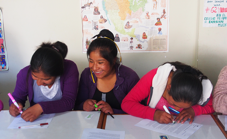 Young women completing a worksheet together