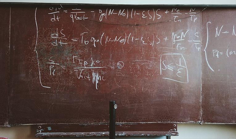Math equations on a chalkboard
