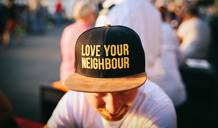 Hat with love your neighbor on it