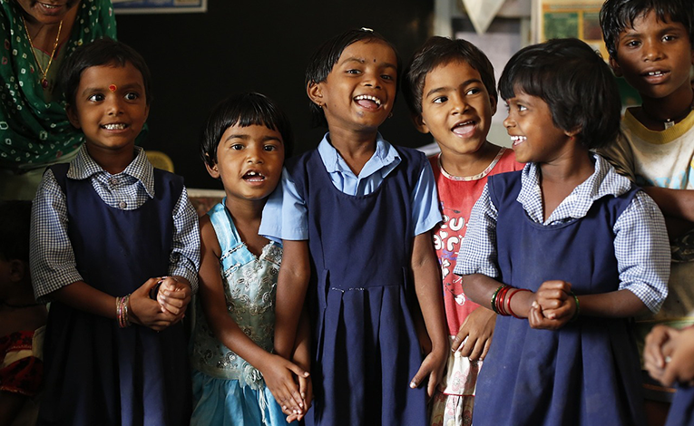 School children smiling with enthusiasm.