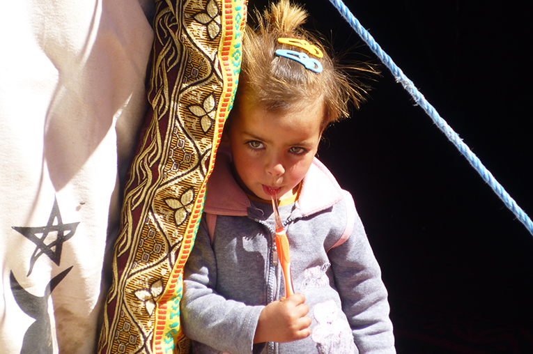 Young Moroccan girl holding a toothbrush