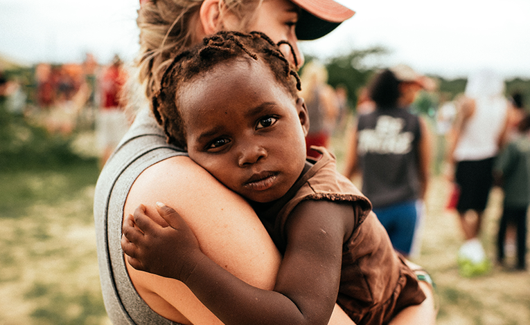 A volunteer woman holding a child