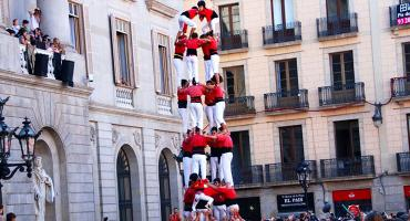 Castellers practicing the time-honored tradition of building human towers in Barcelona