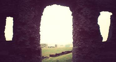 Denbigh Castle on a misty Welsh afternoon.