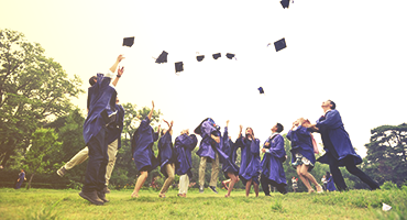 Graduates throwing their caps in the air