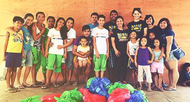 Volunteer with local children and teens in the Philippines