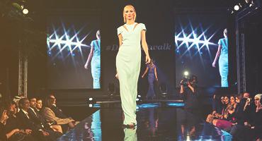 A model walking in a fashion runway.