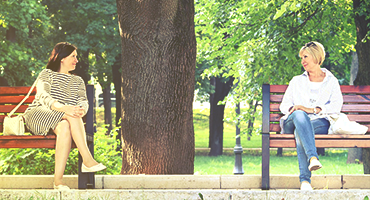 Women talking on a park bench
