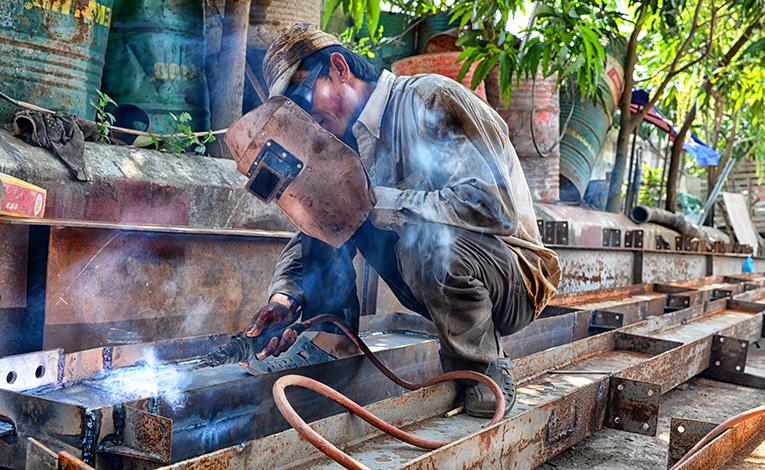 Man welding in Vietnam