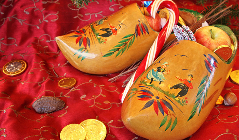 Wooden shoes filled with food and treats