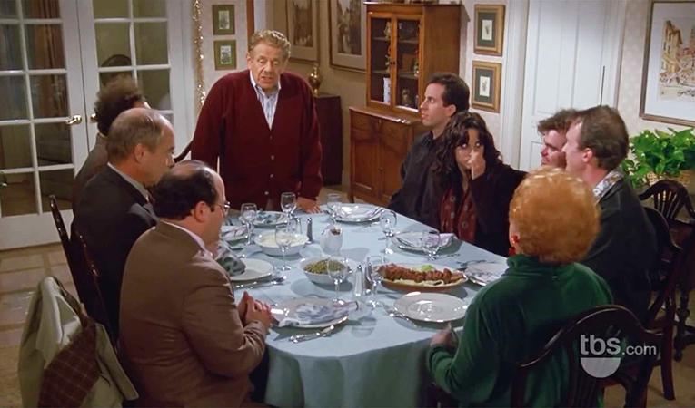 Seinfeld cast gathered around the table celebrating Festivus