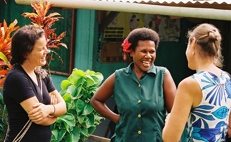 volunteers laughing and chatting in Vanuatu
