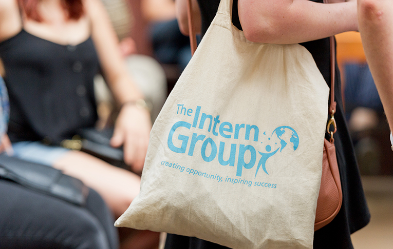 Girl carrying The Intern Group branded bag