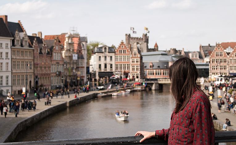 Girl looking out over a river in Brussels, Belgium