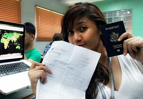 Girl holding a plane ticket and passport