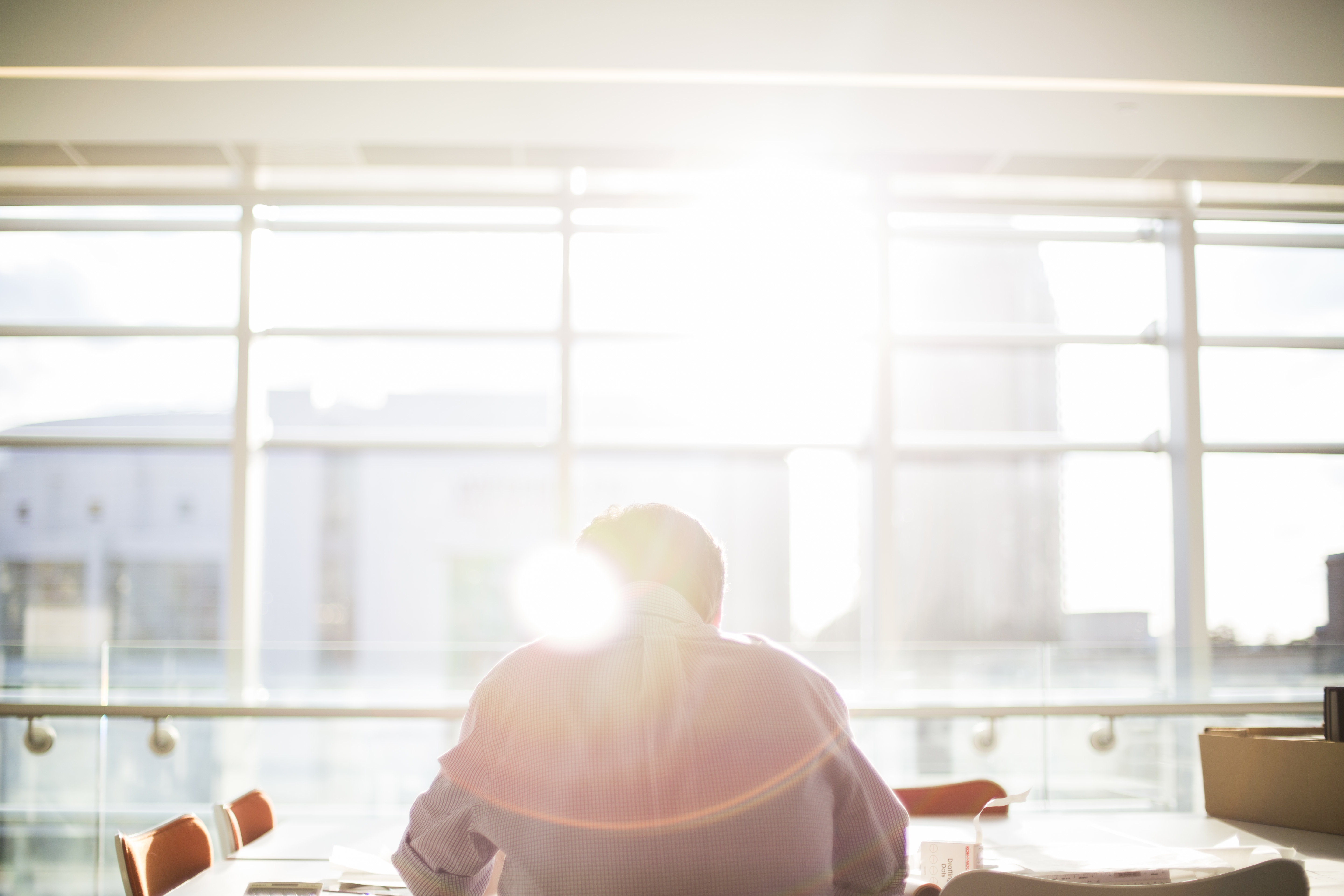 intern sitting at a desk in the sunlight