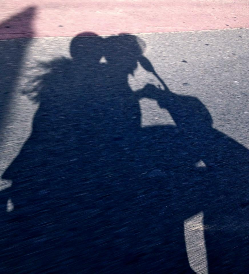 Shadow of two people on a motorbike