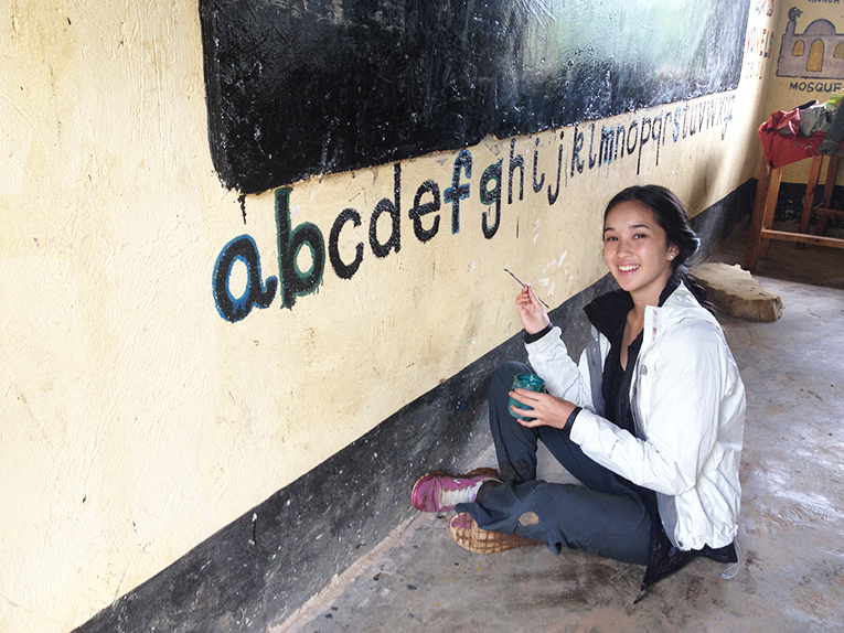 Volunteer painting at an elementary school abroad