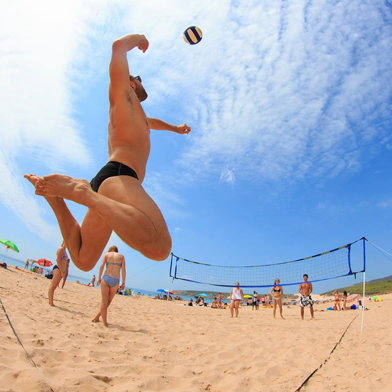 Beach volleyball player in Bolonia, Spain