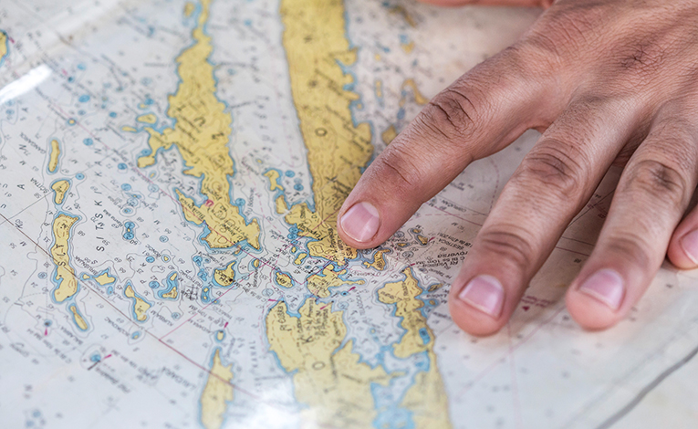 Hand pointing at a map