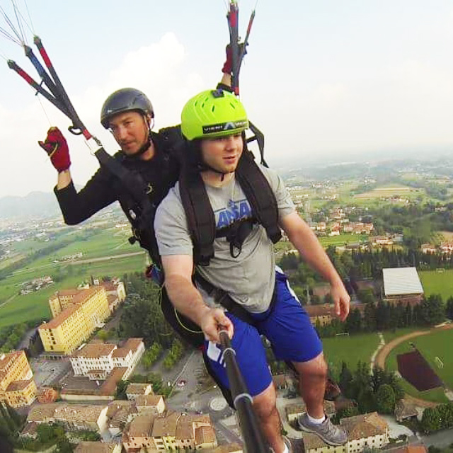 Paragliding over the CIMBA campus in Paderno del Grappa, Italy