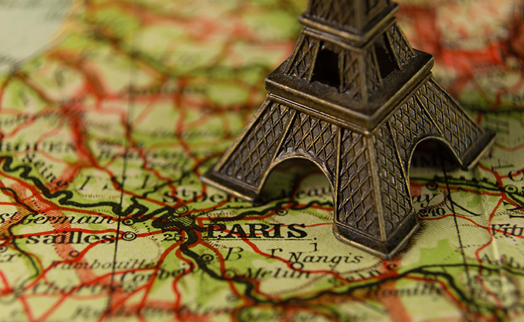 Map of France with an Eiffel Tower trinket