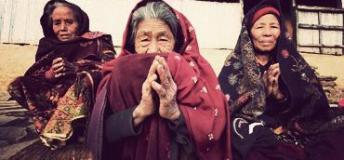Women praying in a temple in Nepal.