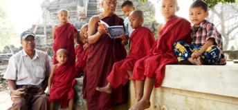 A monk and guide reads Lonely Planet to a group of young monk-orphans in Shwebo, Sagaing Region.