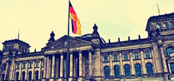 The German flag over the Reichstag in Berlin, Germany