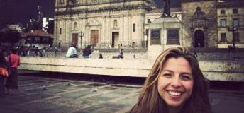 A student poses in front of the Bogota Cathedral in Bolivar Square