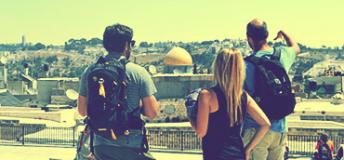 Students look out over the stone walls and ancient buildings of The Old City in Jerusalem, Israel