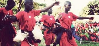 Ugandan students dancing to traditional music